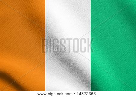 Cote D Ivoire national official flag. African patriotic symbol banner element background. Flag of Ivory Coast waving in the wind with detailed fabric texture, illustration