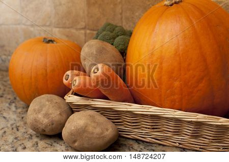 Rectangular wicker basket filled with vegetables such as carrots potatoes broccoli and pumpkins