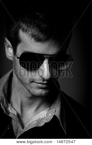 Closeup Of A Young Man Wearing Sunglasses In Black And White
