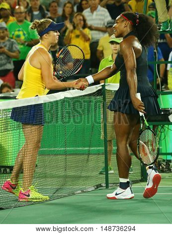 RIO DE JANEIRO, BRAZIL - AUGUST 9, 2016: Olympic champion Serena Williams of United States (L) congratulates Elena Svitolina of Ukraine after loss at round three match of the Rio 2016 Olympic Games