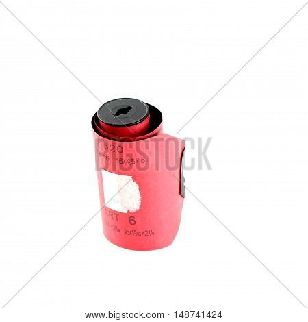 pictureof a vintage camera film roll on white background