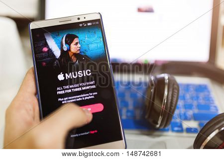 Man Hand Holding Screen Shot Of Apple Music App Showing On Android