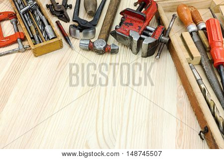 Old Grungy Tool Set On Wooden Boards Background