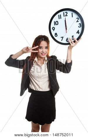 Young Asian Business Woman Show Victory Sign With A Clock.