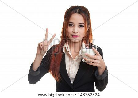 Healthy Asian Woman Drinking A Glass Of Milk Show Victory Sign.