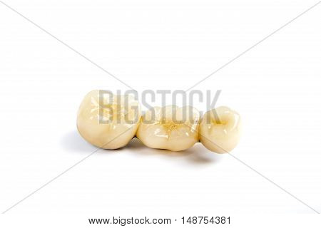 Dental ceramic tooth crowns on white background. Isolated.