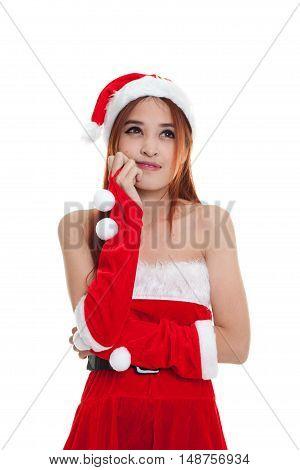 Asian Christmas Girl With Santa Claus Clothes.