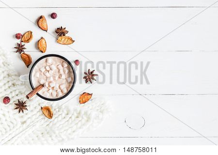 Autumn composition. Hot chocolate knitted blanket dried flowers and autumn leaves. Flat lay top view