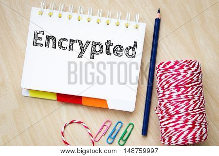 Encrypted, text message on white paper and pencil on wood table / business concept