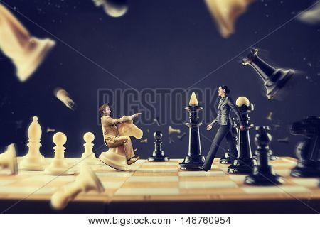 Man and woman on the chess board