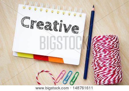creative, text message on white paper and pencil on wood table / business concept