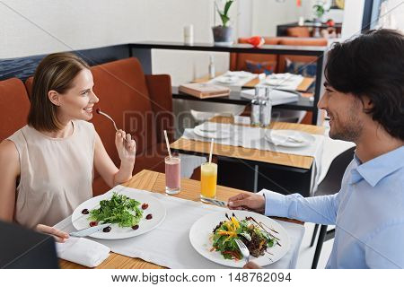 Exceptionally healthy lunch. Cropped shot of happy young couple enjoying tasty lunch in restaurant and smiling