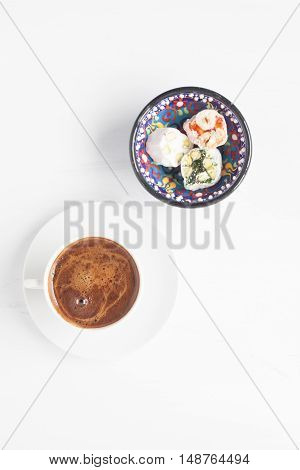 Turkish coffee and Turkish delight on a white background