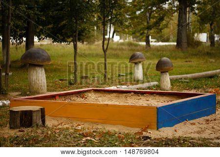 Sandbox. Children's sandpit in the autumn park