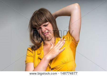 Woman With Sweating Under Armpit In Yellow Dress