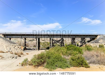 DURMID, CALIFORNIA, USA - MAY 26, 2015: Rail bridge next to California State Route 111 with the logo of the former railroad company Southern Pacific.