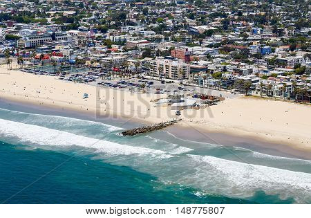 LOS ANGELES, USA - MAY 27, 2015: Aerial view of a part of Venice Beach with colorful residential homes the beach and the ocean.