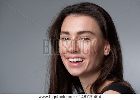 skincare and beauty concept, portrait of a happy smiling freckled girl looking into camera