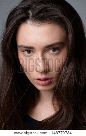 skincare and beauty concept, portrait of a serene pretty freckled woman looking into camera
