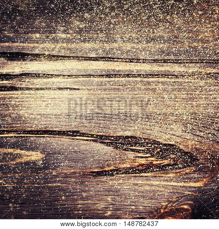 Wooden textured background with colden glitter. Christmas frame background