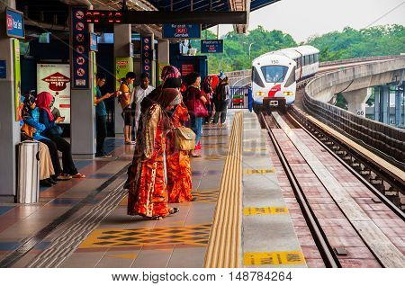 KUALA LUMPUR, MALAYSIA - MAY 2, 2014: People waiting for the monorail in the city center. It covers most of the landmarks and is used by tourists regularly