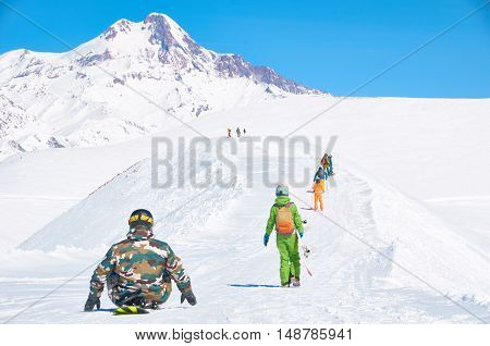 Winter sport cocept with mountain peak snowboarders background. High point on the winter ski resort. Dangerous adventures.