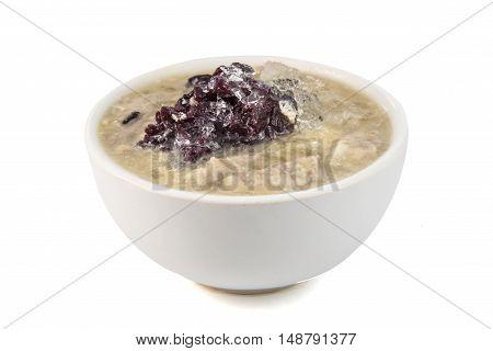 Thai Black Sticky Rice Pudding On White Background