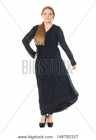 Studio Shot Of A Large Woman In Black Dress Isolated