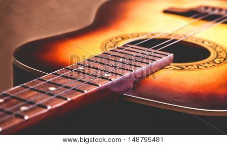 classical yellow guitar of wood Part fretboard and strings