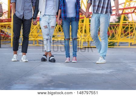 waist down view, friends against the amusement park
