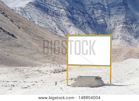 Empty White Signboard In Mountain Background - With Copy Space And Clipping Mask To Advertise And Ma