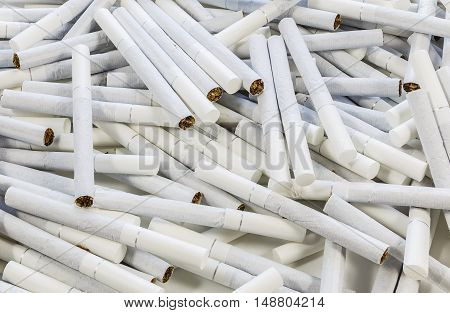 Scattered cigarettes with white filter on the floor