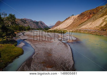Beautiful View Of White River And Colorful Mountains. Altay Region, Russia
