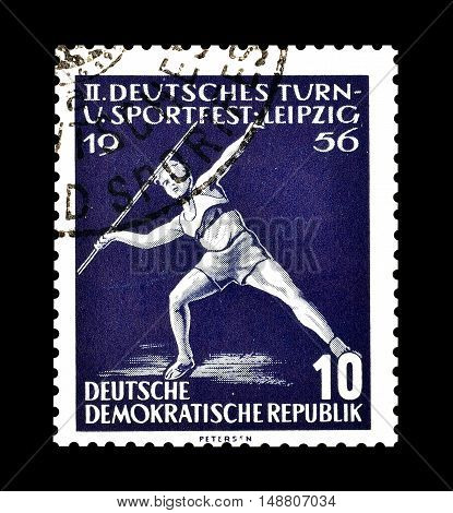 GERMAN DEMOCRATIC REPUBLIC - CIRCA 1956 : Cancelled postage stamp printed by German Democratic Republic, that shows Javelin.