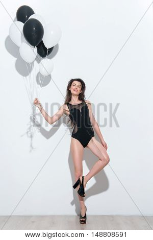 pretty smiling woman standing on white background with copy space