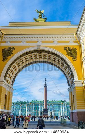 SAINT PETERSBURG RUSSIA - APRIL 25 2015: The Palace Square with the Winter Palace and Alexander Column seen through the great arch of General Staff Building on April 25 in Saint Petersburg.