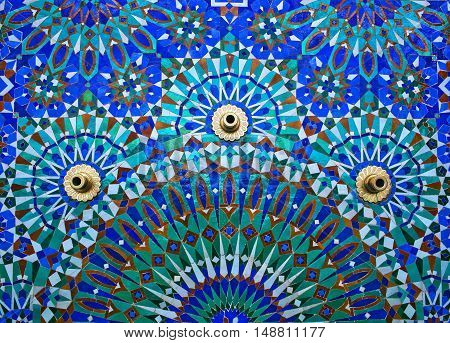Fountain on the wall of Hassan II Mosque in Casablanca Morocco Africa.