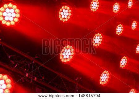 Stage lighting equipment. Modern Concert spotlight. The direct rays of light in the haze.