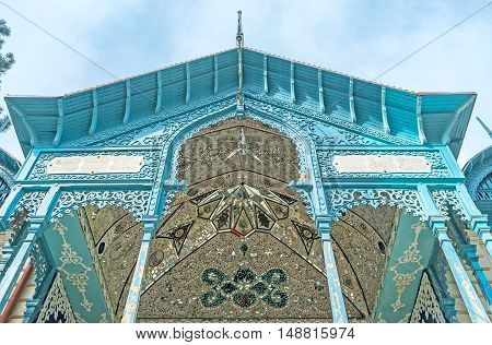 The balcony of Blue Firuza Palace built by Iranian consul decorated with carved wooden traceries and the ceiling is covered with islamic patterns of mirror tiles and painted details Borjomi Georgia.