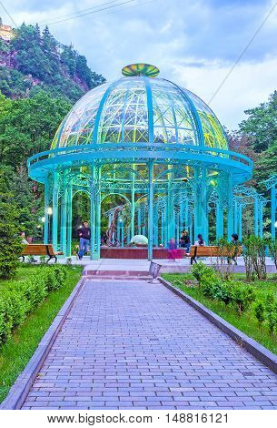 BORJOMI GEORGIA - MAY 27 2016: The Mineral Water Park becomes bright and colorful in the evening on May 27 in Borjomi.