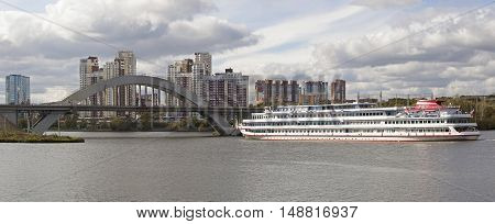 Panorama of the City of Moscow, with the river steamer and a bridge in the autumn.
