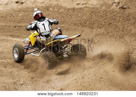 ATV quadbike rider driving in the race