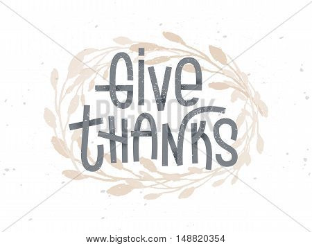 Give Thanks thanksgiving lettering with a golden wreath under it. Typographic greeting card on white background