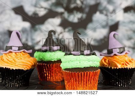 Delicious cupcakes decorated with fondant figures for Halloween