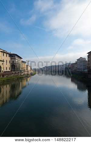 Portrait view of the river in downtown Florence Italy