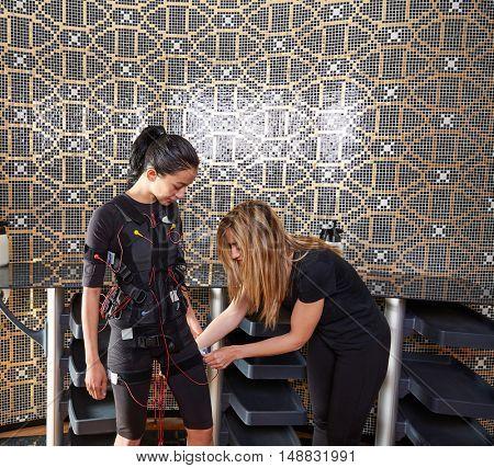 EMS electro stimulation coach suit helping women