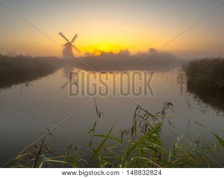 Windmill On A Lake