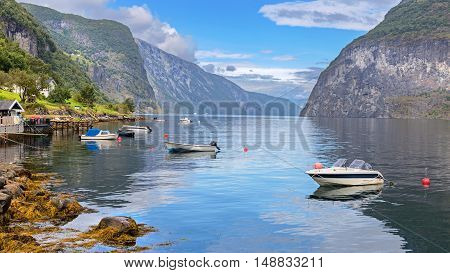 Boats in Undredal with the fjord in the background Norway
