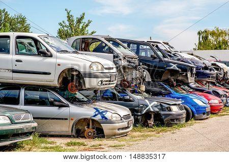 crashed cars junkyard scrap material stack automobile