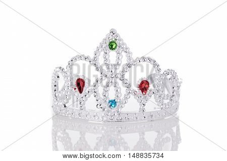 Toy silver plastic crown isolated on white background
